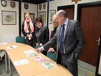 Image of judges looking at poster designs