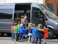 Image of children getting into a minibus