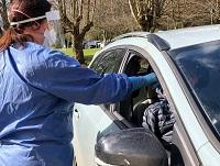Image of person in car being test for coronavirus