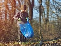 Image of a boy litter picking