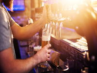 Image of a man pouring a pint