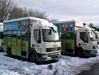 Image of recycling lorries in the snow
