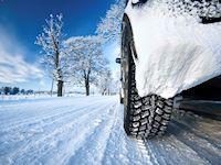 Image of a car tyre in the snow