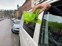 Image of litter being thrown out of a van window