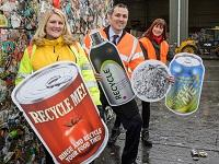 Image of a group of people with promotional recycling props