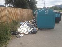 Image of fly-tipping outside recycling banks