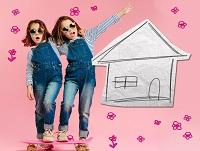 Image of two young girls next to a hand drawn house
