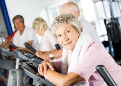 Image of older people using fitness equipment