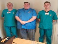 Three male homecare workers