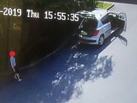 Image of CCTV still of person fly-tipping