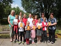Image of pupils with vouchers after winning recycling competition