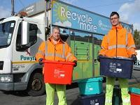 Image of council staff with recycling boxes