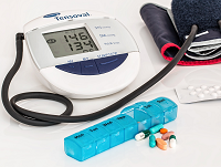 Image of a blood pressure monitor and some tablets